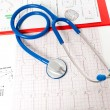 Foto Stock: Stethoscope over electrocardiogram