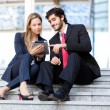 Portrait of two business people at work — Stock Photo