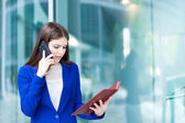 Busy businesswoman at work — Stock Photo