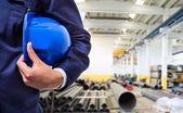 Worker holding his helmet — Stock Photo