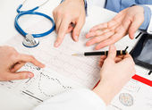 Doctors examining medical tests — Stock Photo