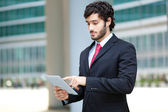Young businessman using a tablet — Stock Photo