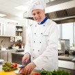 Chef cooking in his kitchen — Stock Photo