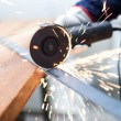 Grinder cutting a metal plate — Stock Photo