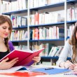 Students in a library — Stock Photo #30861135