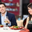 Couple having dinner in a restaurant — Stock Photo