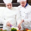 Stock Photo: Chefs at work