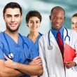 Doctor in front of his medical team — Stock Photo #30862075