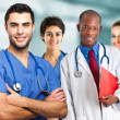 Stock Photo: Doctor in front of his medical team
