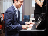 Man playing piano — Stock Photo