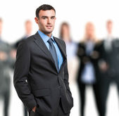 Smiling businessman in front of his team — Stock Photo