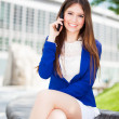 Portrait of an attractive woman talking on the phone — Stock Photo