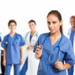 Stock Photo: Nurse in front of her medical team