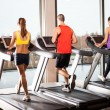 People running on treadmills — Foto Stock #31524215