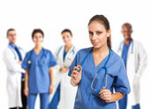 Nurse in front of her medical team — Stock Photo