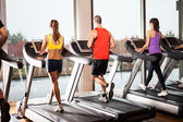 People running on treadmills — Stock Photo