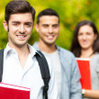 Outdoor portrait of a smiling students — Stockfoto #32389647