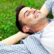 Young man relaxing on the grass — Stok fotoğraf