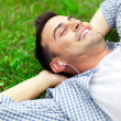 Young man relaxing on the grass — Foto de Stock