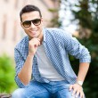 Man posing outdoors with sunglasses — Stock Photo #32389737