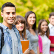 Outdoor portrait of a smiling students — Stock Photo #32389741