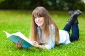 Female student lying on the grass — Stock Photo