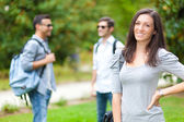 Outdoor portrait of a smiling students — Stock Photo
