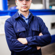 Portrait of a worker in a factory — Stock Photo