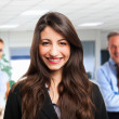 Businesswoman in front of his team — Stock Photo