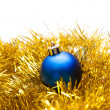 Blue Christmas ball on a golden decoration — Stockfoto
