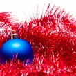 Blue Christmas ball on a red decoration — Stok fotoğraf