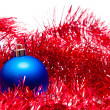 Blue Christmas ball on a red decoration — Stock fotografie