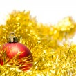 Red Christmas ball on a golden decoration — Foto Stock