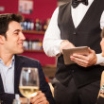 Waiter using a digital tablet — Stock Photo #32801885