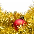Red Christmas ball on a golden decoration — Stock Photo