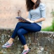 Girl with notebook in the city. — Stockfoto