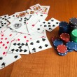 Playing cards near some poker chips — Stock Photo #32802375