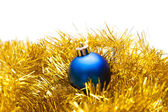 Blue Christmas ball on a golden decoration — Stock Photo