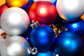 Many Christmas baubles — Stock Photo