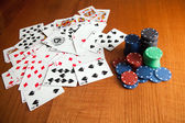 Playing cards near some poker chips — Stock Photo
