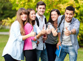 Group of students with thumb up — Stock Photo