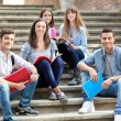 Students sitting on stairs — Stok fotoğraf