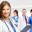 Doctor in front of her team — Stock Photo