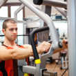 Man training in a fitness club — Stock Photo #33266901
