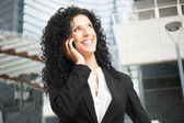 Beautiful woman talking on the phone — Stock Photo