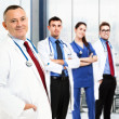 Stock Photo: Doctor in front of his team