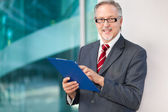 Businessman with clipboard — Foto de Stock