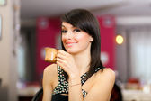 Woman enjoying a coffee at the restaurant — Stock Photo