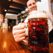 Bartender serving a giant beer — Stock Photo