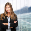 Beautiful businesswoman with crossed arms — Stock Photo